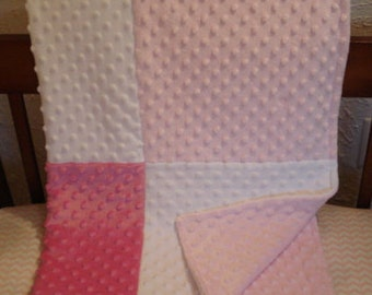 Soft and thick white, baby pink and carnation bubble blanket, with baby pink bubble backing.