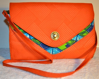 """Vibrant Colored African Print Sling bag with Detachable straps. """"Doyinsola"""" Collection."""