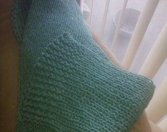 Beautiful handmade scarf color teal.