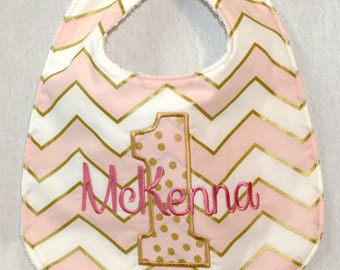 Girl's First Birthday Bib  - Pink and gold metallic chevron with polka dot 1.   Includes personalization.