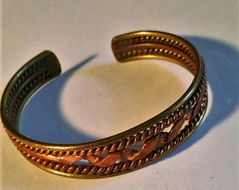 Vintage unsigned Copper and Brass Cuff Bracelet with a twisted design