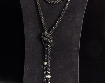 Black 1970's flapper revival necklace-- crocheted cotton and cut glass beads