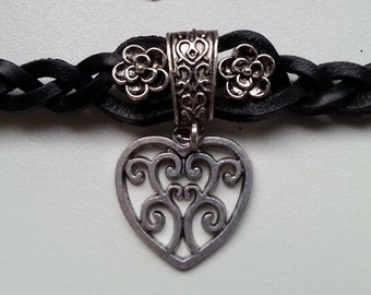 Leather bracelet in a traditional style with heart