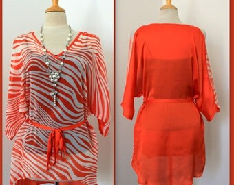 The Zebra Print Classic Cold Shoulder Tunic top with cut out details to the shoulder Over Sizes .S/M/L.