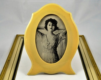 Art Deco celluloid picture frame with period photo
