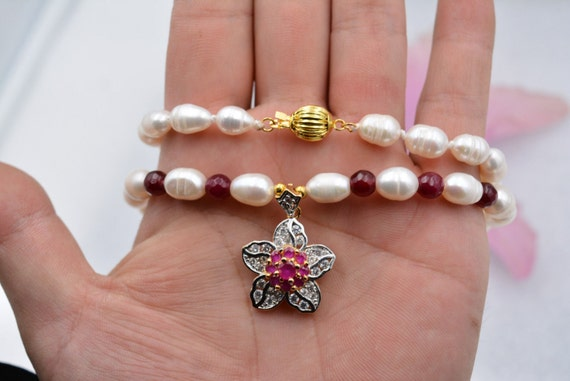 Lovely white freshwater cultured pearl and garnet necklace with rhinestone pendant