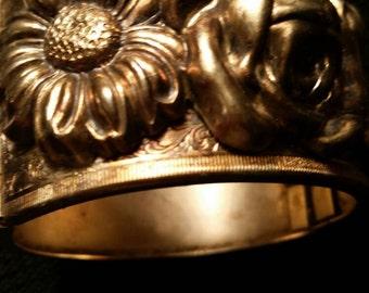 Flower clamp bracelet