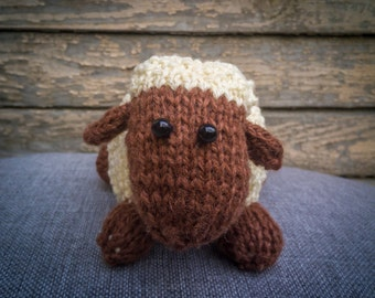 Hand knitted sheep soft toy