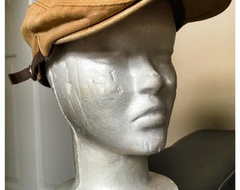 Khaki colored size adjustable paperboy hat made by Grace