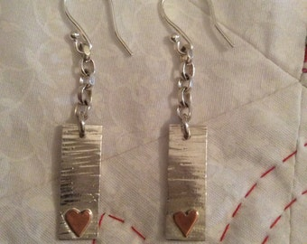 Hammered silver earrings with copper hearts