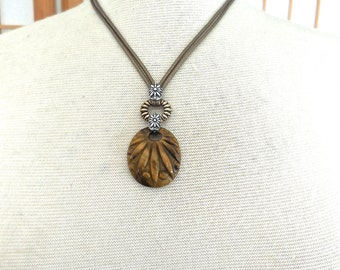 Vintage Carolyn Pollack Necklace in Sterling Brass and Large Carved Tiger Eye Pendant Hanging on Leather