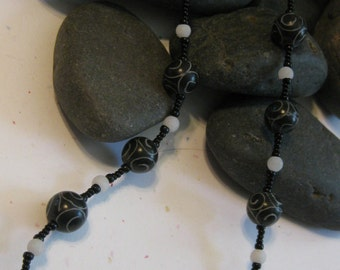 Black agate with silvery swirl carvings, bead necklace