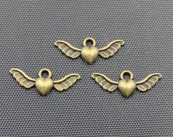 30pcs Winged Heart Charm Antique Bronze Tone 27x10mm - BH317