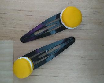 Barrettes hair yellow badge