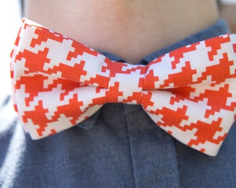 Bowtie pixel geometry, orange and white, man, pre-noue and adjustable