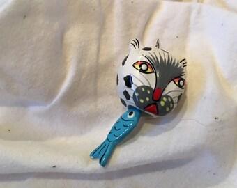 Whimsical  plasticized papier mache cat and fish pendant
