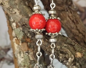 Red Feather with red coral accent bead.
