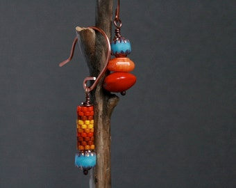 mismatched ethnic earrings with handmade bead and exotic orange seed - bohemian jewelry - asymmetrical dangle earrings