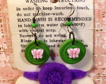Tiny pink butterfly earrings vintage packaging vintage clothing tag pink and green