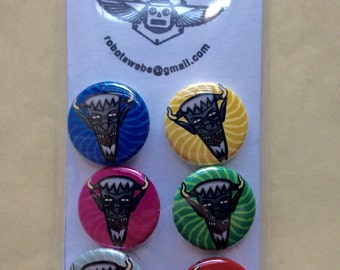 A set of (5) 1 inch Krampus buttons