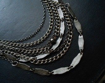 infinite scorn - spiked silver and gunmetal layered necklace - statement jewelry bib necklace