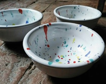 Ceramic bowls in bright colors. Suitable for cooking