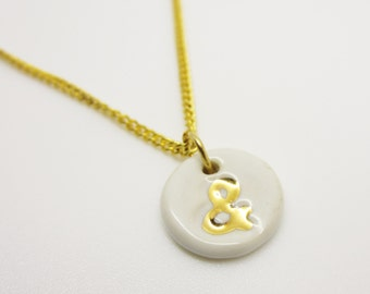 Metallic Gold Small Ampersand Stamped Necklace Glazed Ceramic Porcelain on an 18 inch Gold Chain