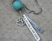 I Kissed a Pit Bull and I Liked It hand-stamped aluminum pendant with silver-plated bead cap and paw print blue bead