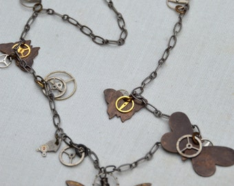 Time Flies. Brass butterfly and watch parts one of a kind charm necklace. Butterfly, time themed necklace