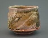 Guinomi, wood-fired iron rich stoneware with crawling shino, tenmoku and natural ash glazes