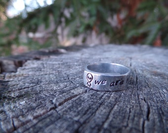 We are not alone, alien hand stamped ring in aluminum
