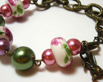 Rabbit Tea Party Bracelet - Antiqued gold bunny charm with ceramic rose teacup pattern beads and faux pearls