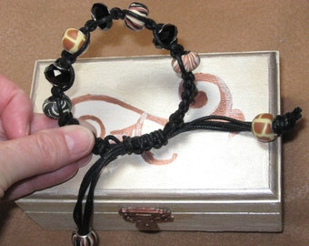 Animal print Pandora like charms on Linen cord with macrame knots. Slider bracelet Great accessory for Casual wear.