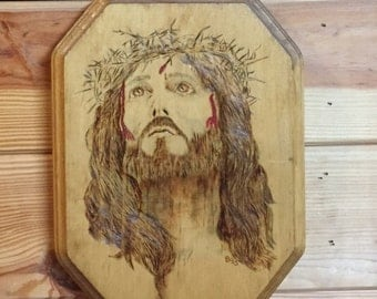 Jesus wearing a crown of thorns wood burned