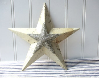 Antique ledger paper metal star silver German glass glitter star center collaged mixed media 8 inch wall hanging