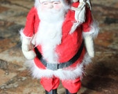 Vintage Japan santa doll with pack