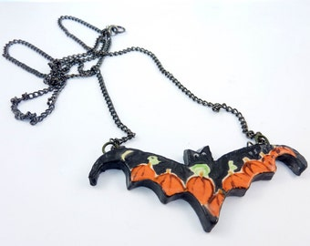 "Handmade Ceramic Bat and Pumpkin Necklace or  Pendant.   Halloween Necklace. Extra Long Chain.  Approximately 32"" or 82 cm Long."