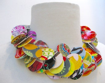 Colorful paper,laminated round circles, using magazine and book papers. Short necklace, full,colorful and lightweight.