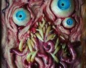 Four Eyes framed mutant sculpture