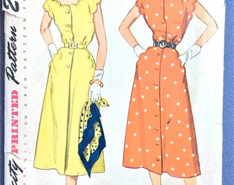 Early 1950s One-Piece Dress Scallops accent the pockets, neckline, and cap sleeves Simplicity 3253 Vintage Sewing Pattern Bust 34