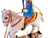 Vintage litho tin soldier ornament on horse