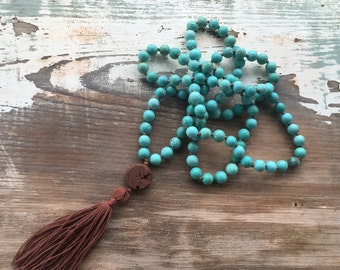 Hand knotted turquoise magnesite mala prayer beads with brown lava essential oil diffuser