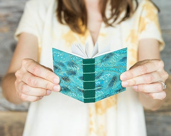 Tiny handmade book with waves pattern paper