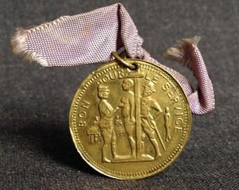 Good to serve. Vintage fun military conscript medal. French school army souvenir coin.