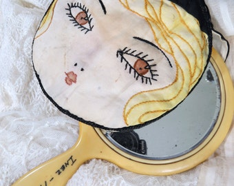 Vintage Hand Mirror with Padded Cover, Embroidered Flapper Face, Vanity, French Ivory Pyralin Celluloid. Beveled