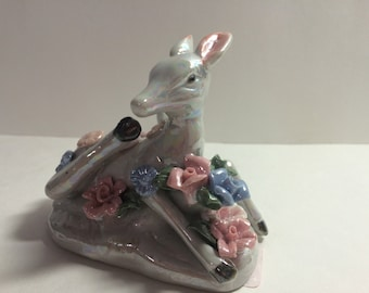 Kitch iridescent deer with flowers