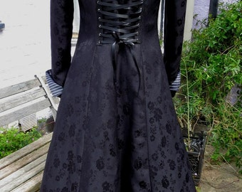 black jacquard underbust coat fully lined in pinstripe.  back corset style lacing