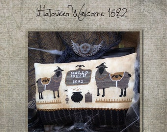 SAVE 20% OFF Halloween Welcome 1692 cross stitch pattern by The Primitive Hare at thecottageneedle.com 1600s cauldron October tombstone