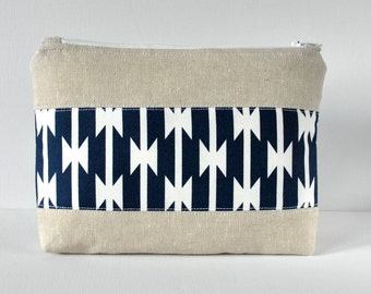 Woman's linen padded beauty travel bag Native American print panel cosmetics make up pouch in navy blue and white.
