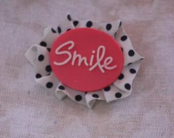 smile ribbon rosette pin